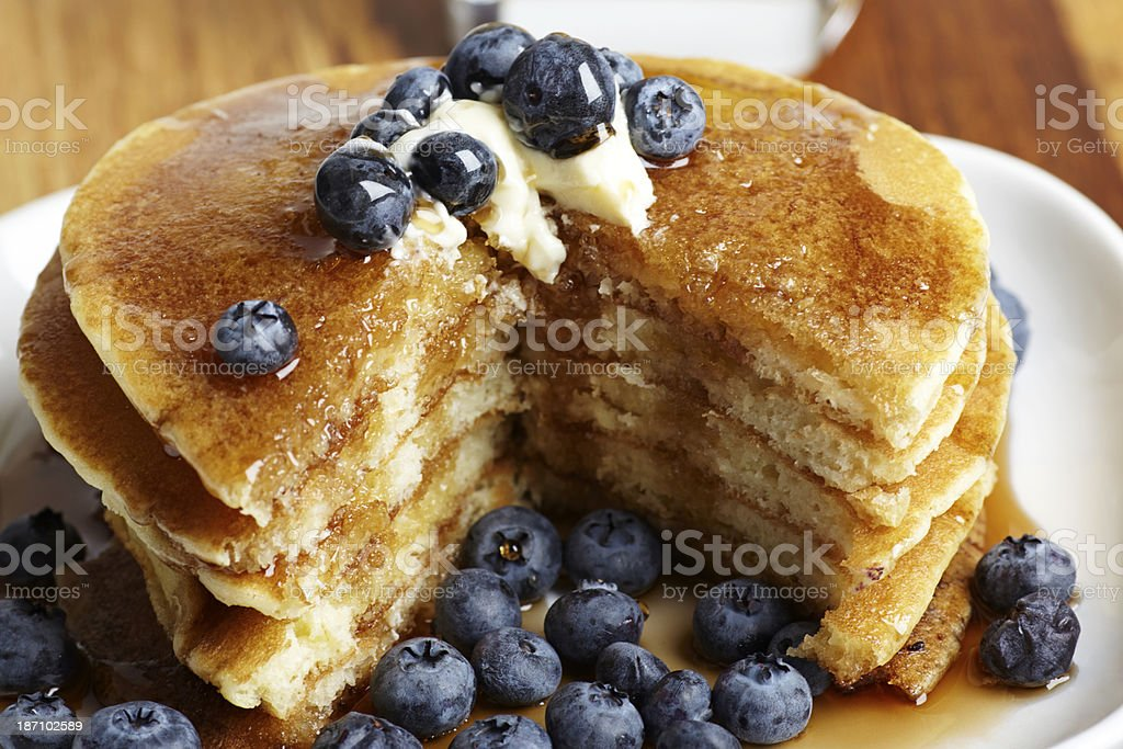 Pancakes with blueberries sliced stock photo