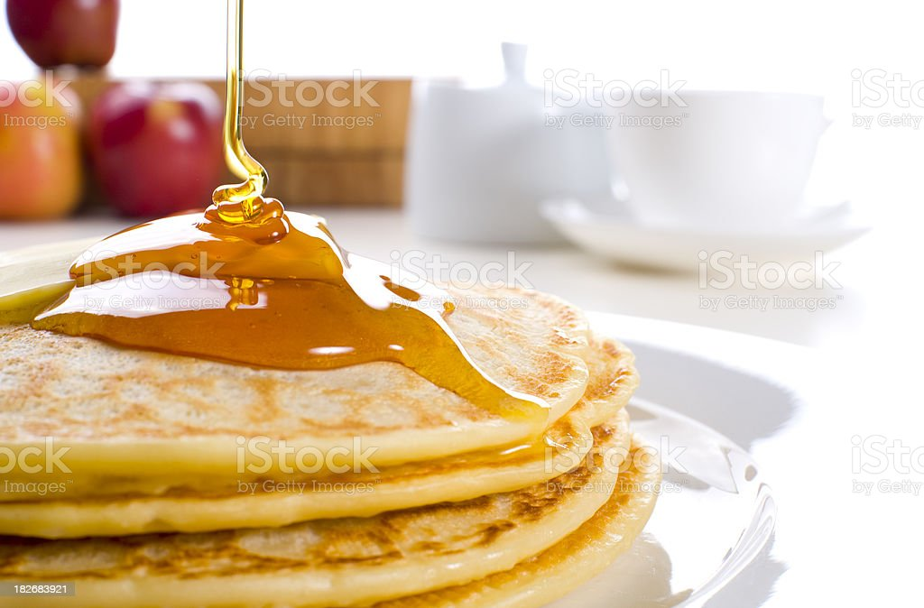 Pancakes with butter and syrup. Coffee, sugar, fruit royalty-free stock photo