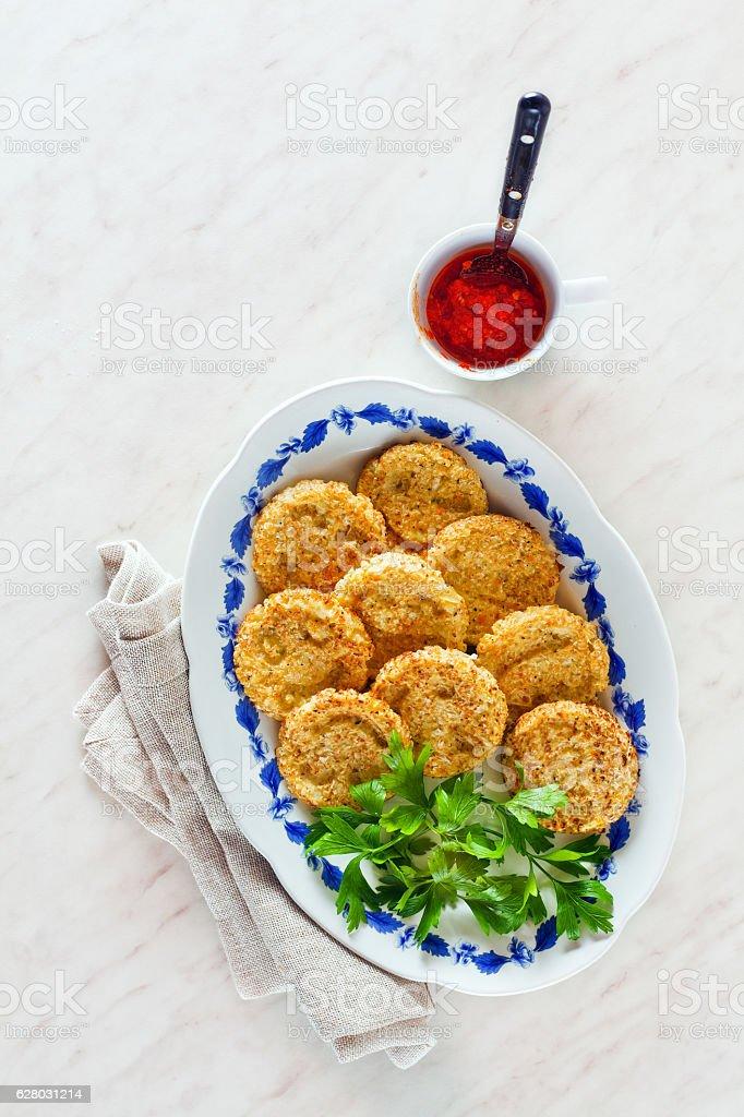 pancakes with cauliflower sauce adjika stock photo