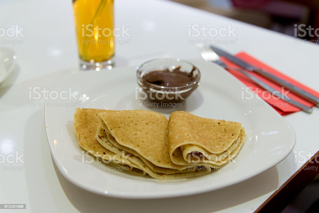 Pancakes with chocolate  on  plate stock photo
