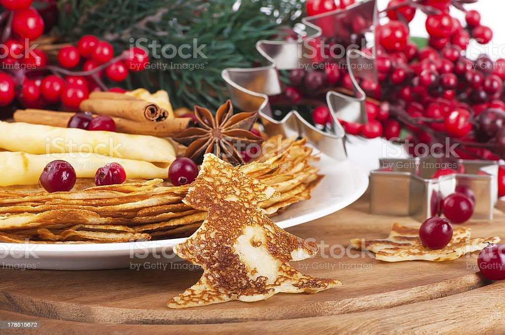 Pancakes with christmas berries royalty-free stock photo