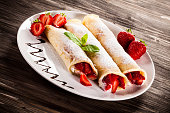 Pancakes with cream and fruits
