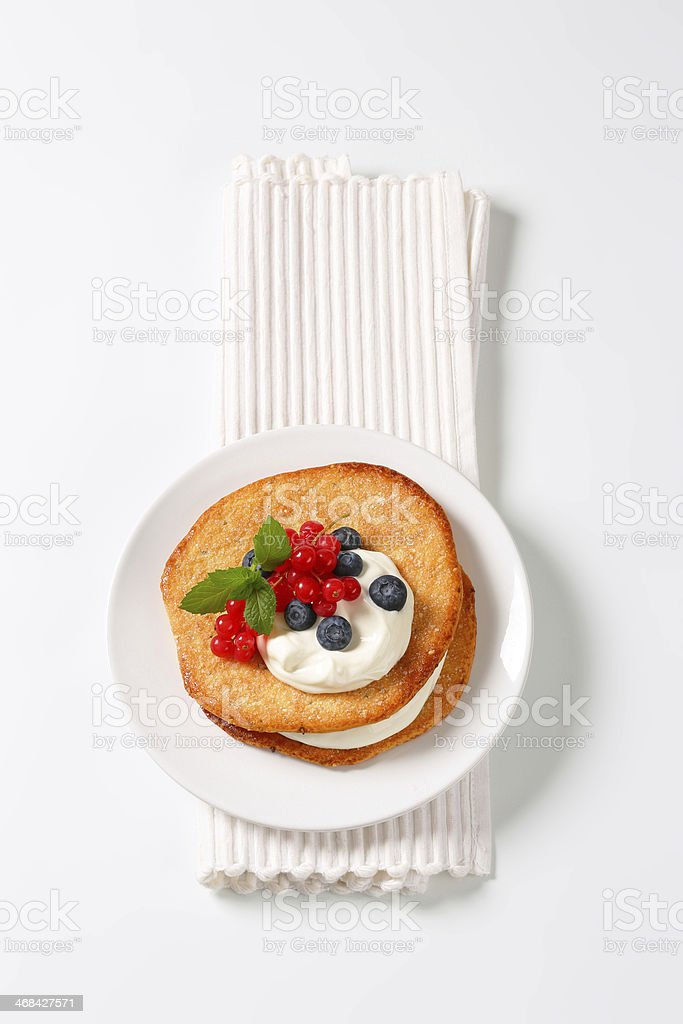pancakes with fruits and whipped cream stock photo