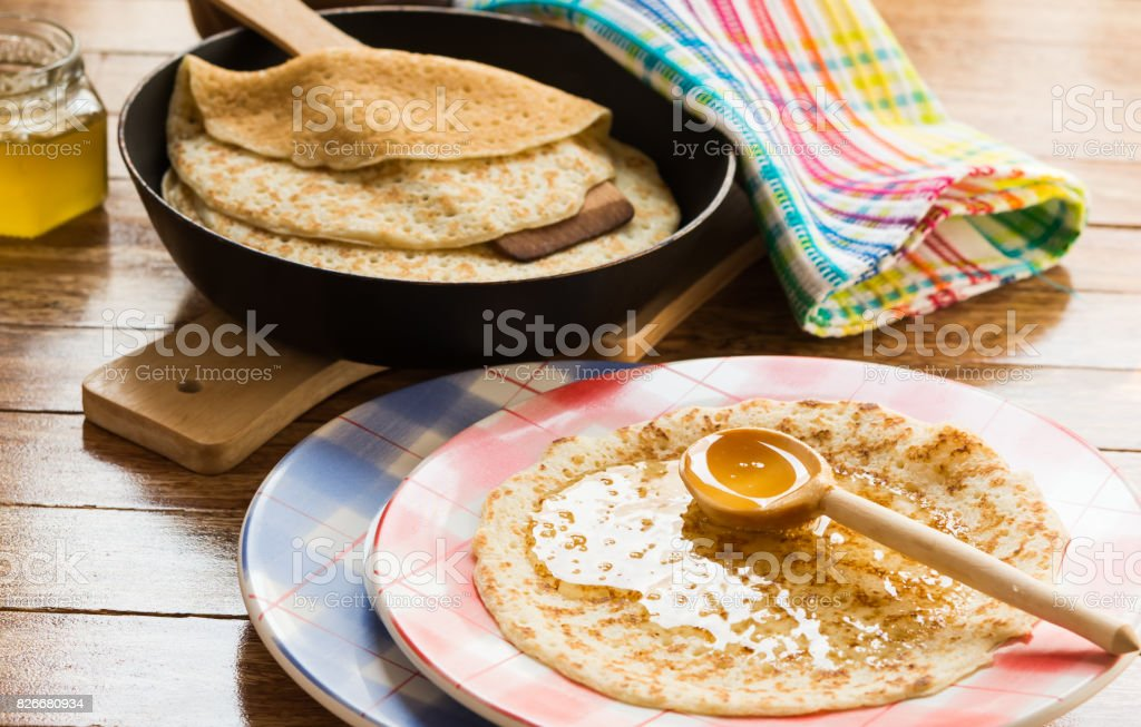 Pancakes with honey. Traditional Russian food - pancake week stock photo