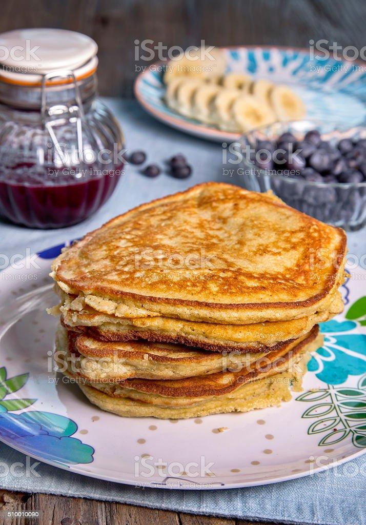 Pancakes with jam, berries and bananas stock photo