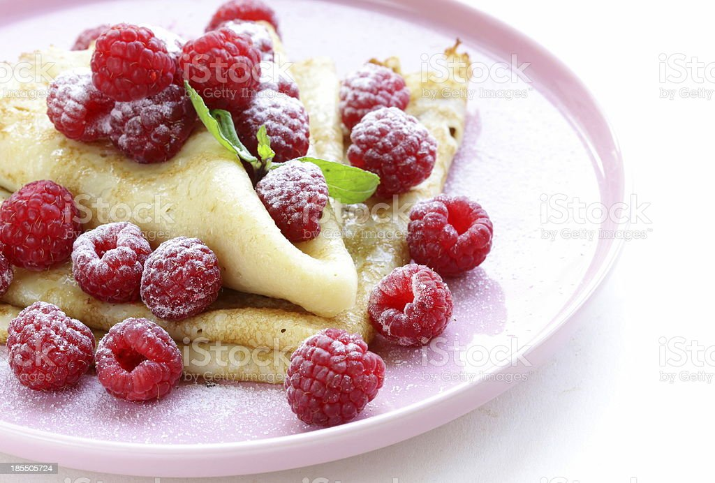 pancakes (crepes) with raspberries and mint royalty-free stock photo