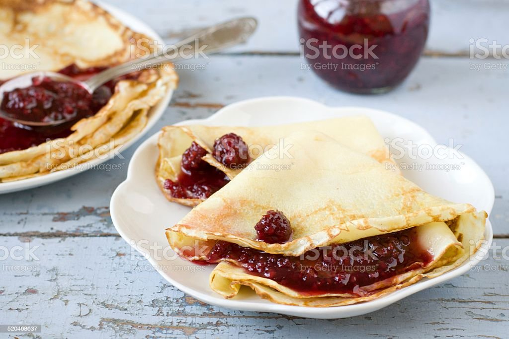 Pancakes with raspberry jam royalty-free stock photo