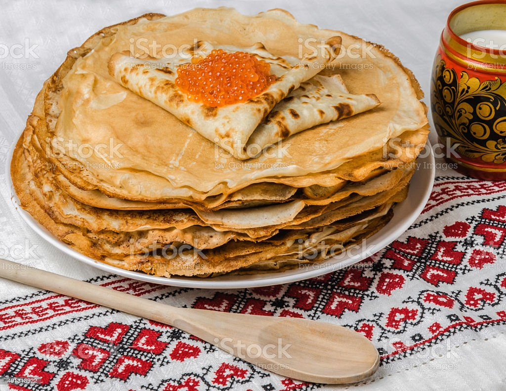 Pancakes with salmon caviar traditional Russian meal on cross st stock photo