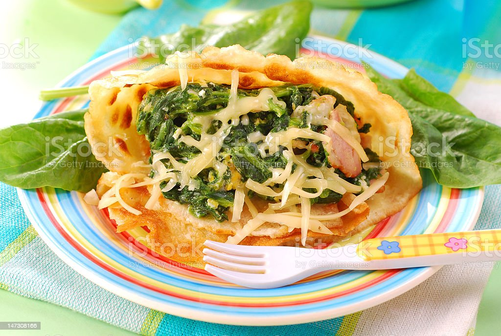 pancakes with spinach for child royalty-free stock photo
