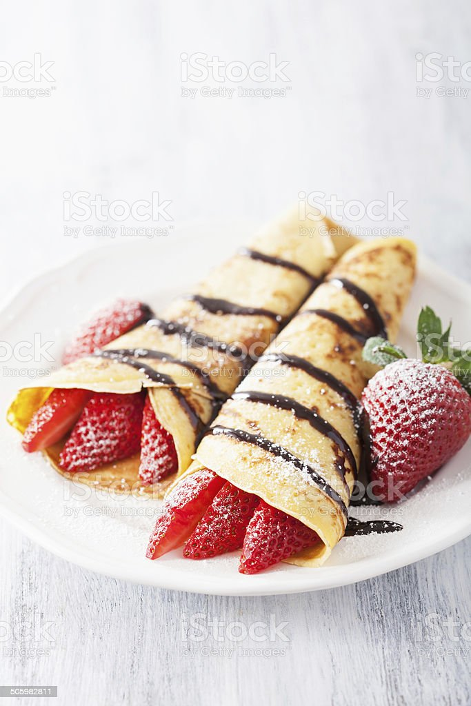 pancakes with strawberry and chocolate sauce stock photo