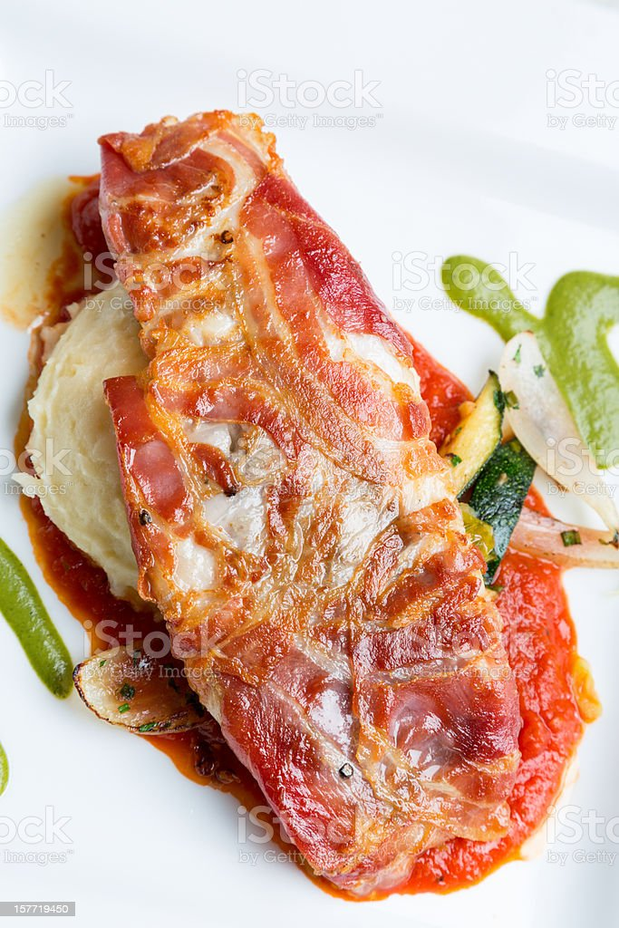 Pancetta Wrapped Sea Bass royalty-free stock photo