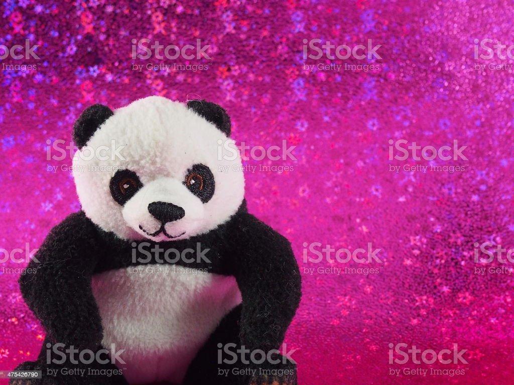 Panda Bear Doll on the Pink Bokeh Background stock photo