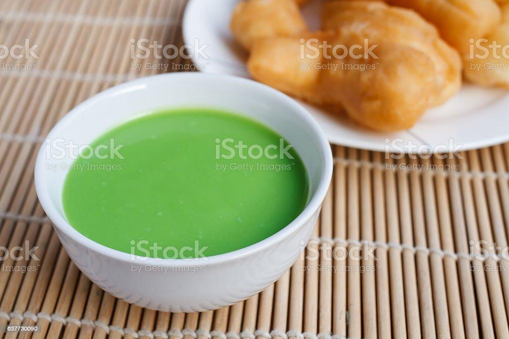 Pandan coconut custard dip and chinese bread stick stock photo