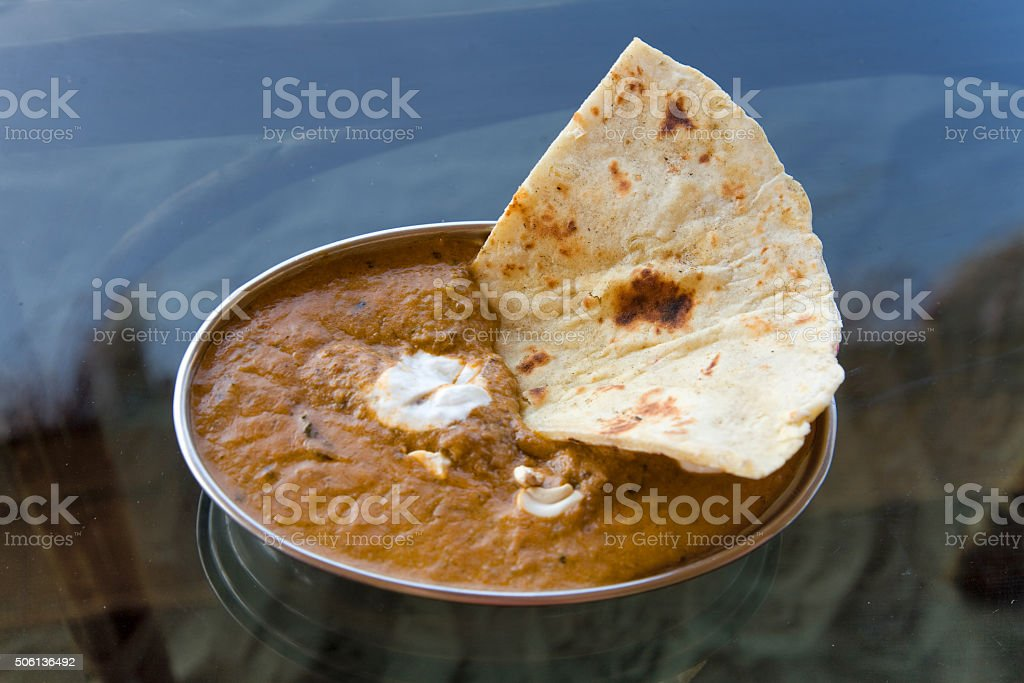 paneer  and cheese curry , indian food  in  metal bowl stock photo