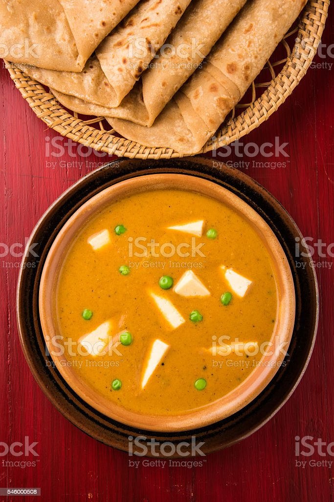 paneer butter masala with chapati / roti / paratha stock photo
