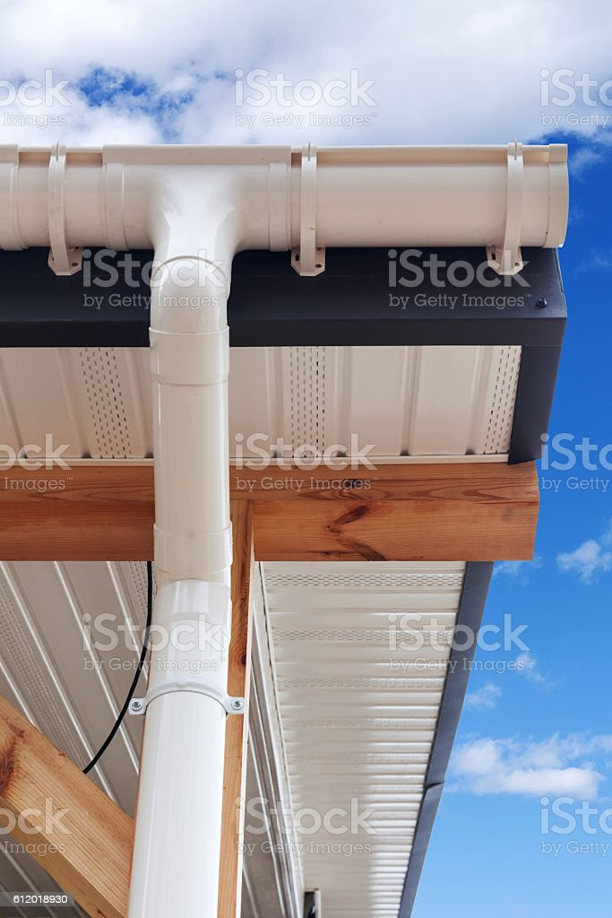 SIP panel house construction. New white rain gutter. stock photo