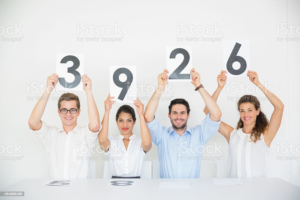 Panel judges holding score signs stock photo