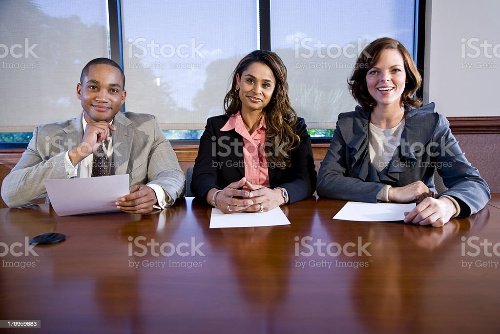 Panel of three multiracial businesspeople royalty-free stock photo