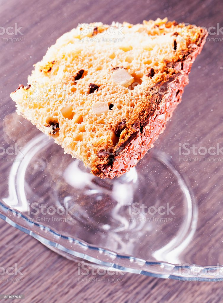 Panettone, slice over glass stand stock photo