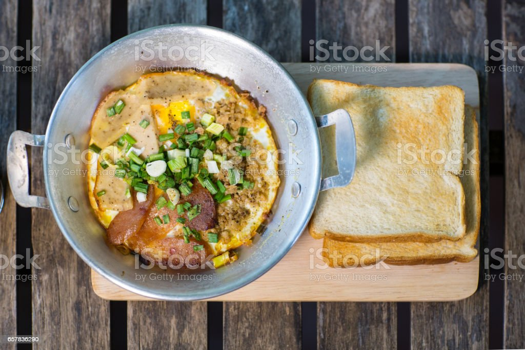 Pan-fried egg with toppings stock photo