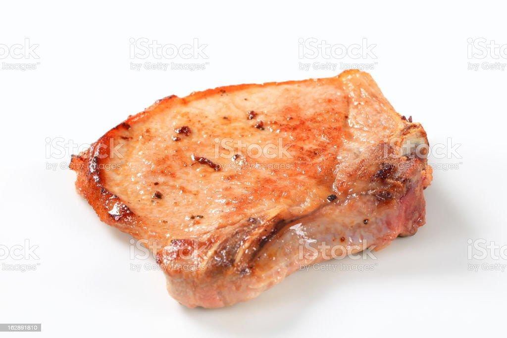 Pan-fried pork chop royalty-free stock photo