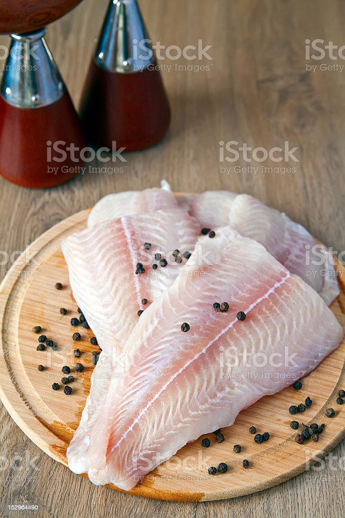 Pangasius Fillet And Black Pepper royalty-free stock photo