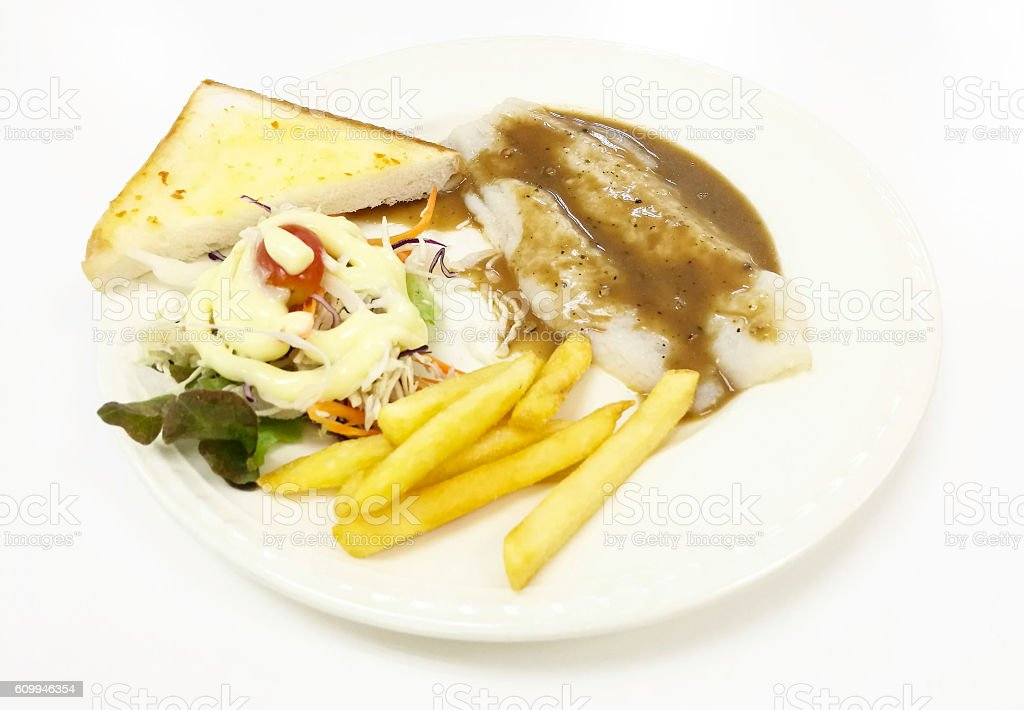 Pangasius Fish Steak Vegetables Salad Toast Bread With French Fried stock photo