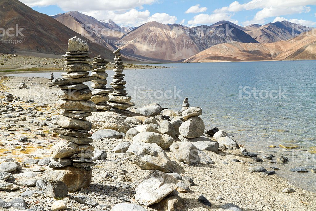 Pangong Tso mountain lake panorama with Buddhist stupas in forefront stock photo