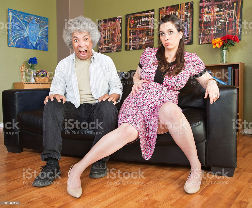 Panicking Man with Pregnant Woman stock photo