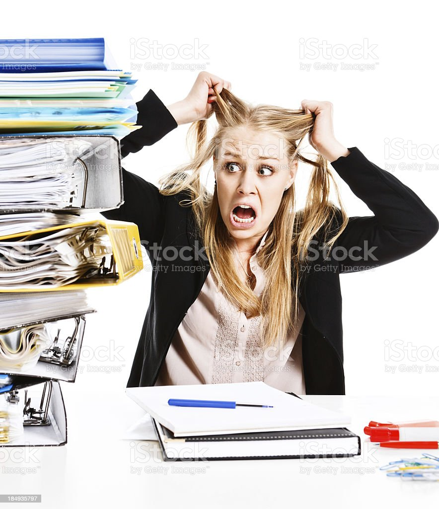 Panic-stricken businesswoman tears hair out in frustration royalty-free stock photo
