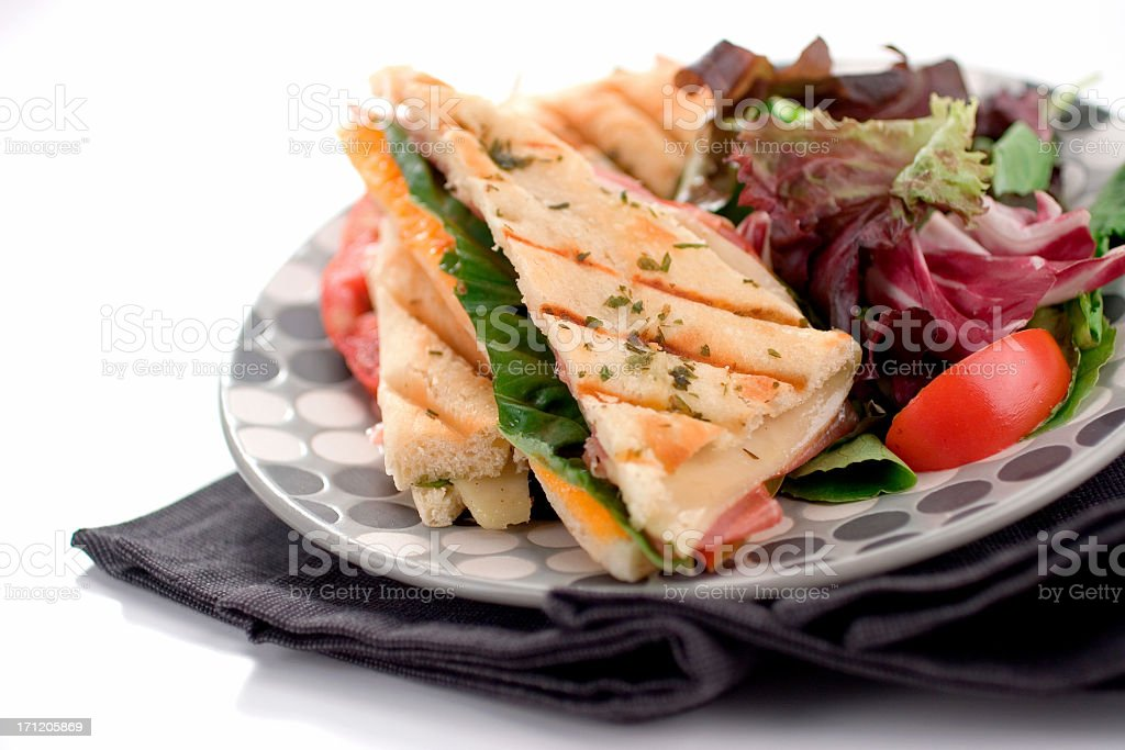 Panini sandwich with salad, served on a plate  royalty-free stock photo