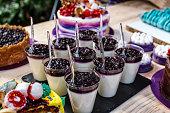 Panna cotta creamy milk dessert with bilberries on wooden background
