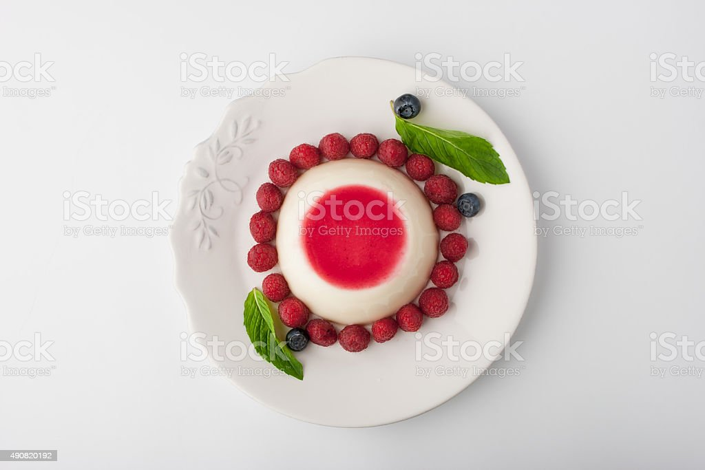 Panna cotta with berries and mint  top view stock photo