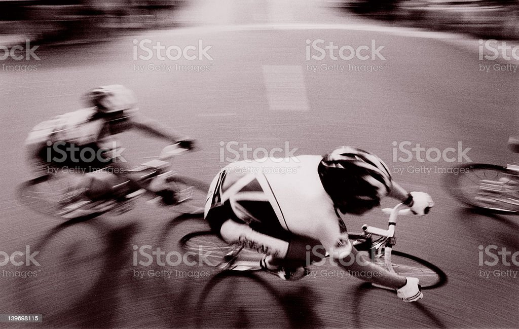 Panned action photo of cyclists competing in a bicycle race. royalty-free stock photo