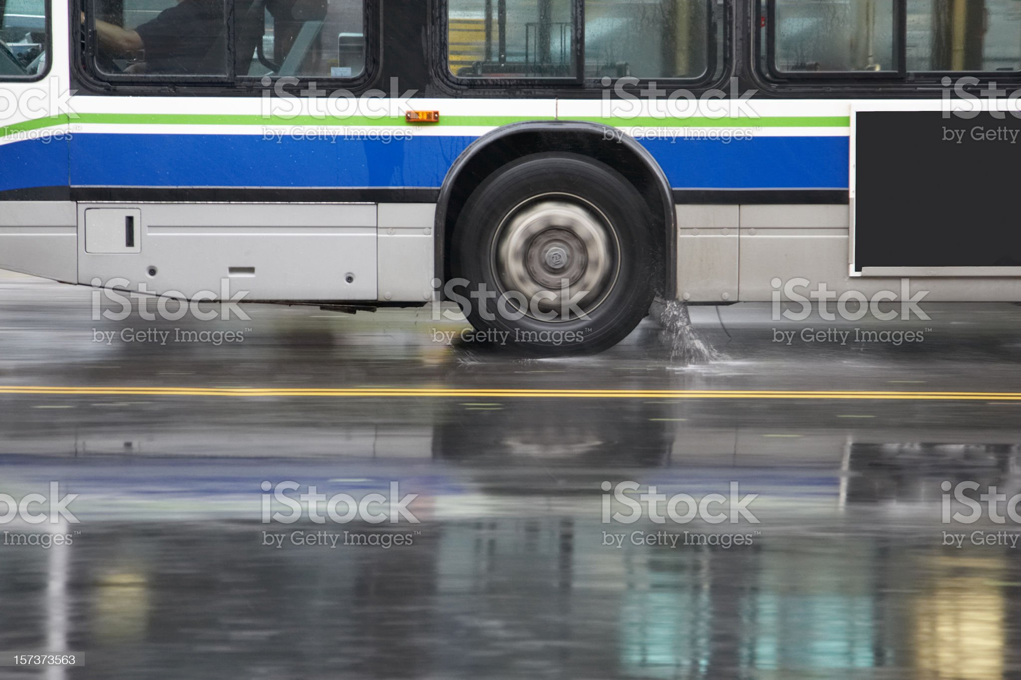 Panned bus in heavy rain royalty-free stock photo