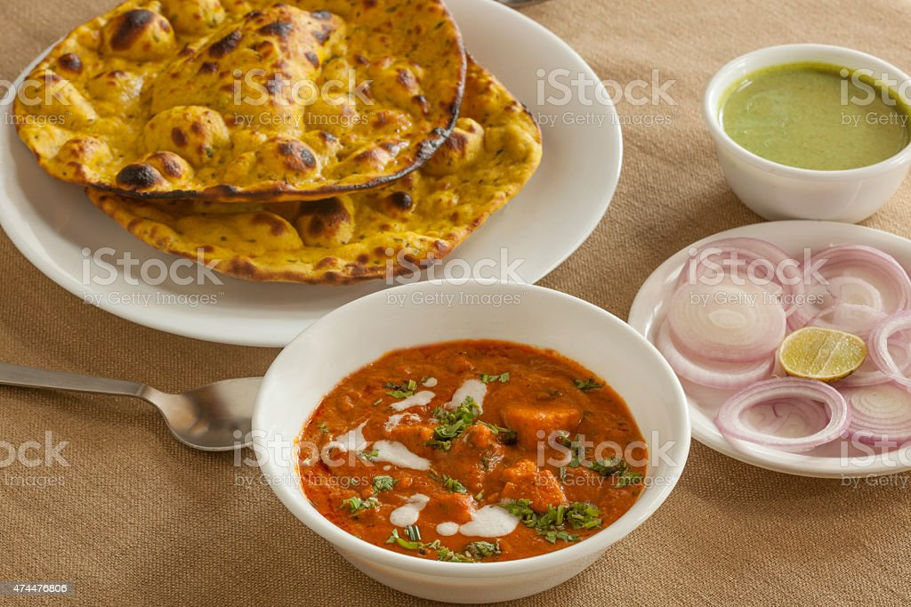 Panner butter masala with missi roti stock photo