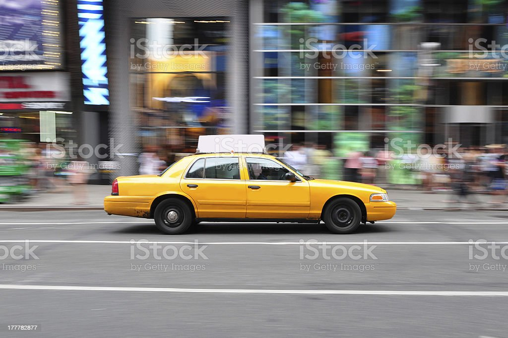 Panning Shot of New York City Taxi Cab stock photo