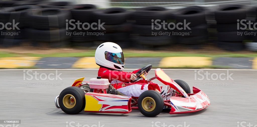 Panning shot of young boy in a gokart stock photo