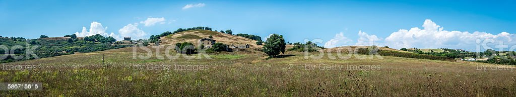 Panorama: Abandoned farm house on a hill stock photo