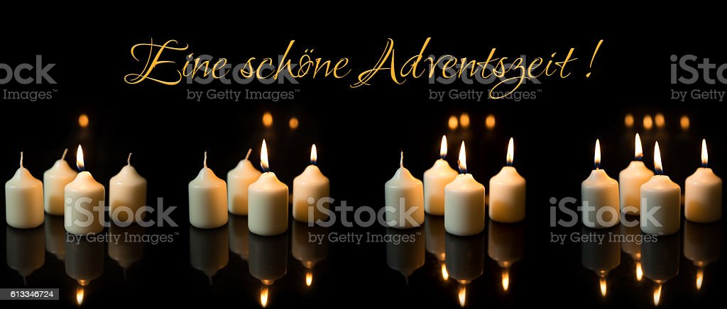 Panorama, advent season with a lot of candles, german text stock photo