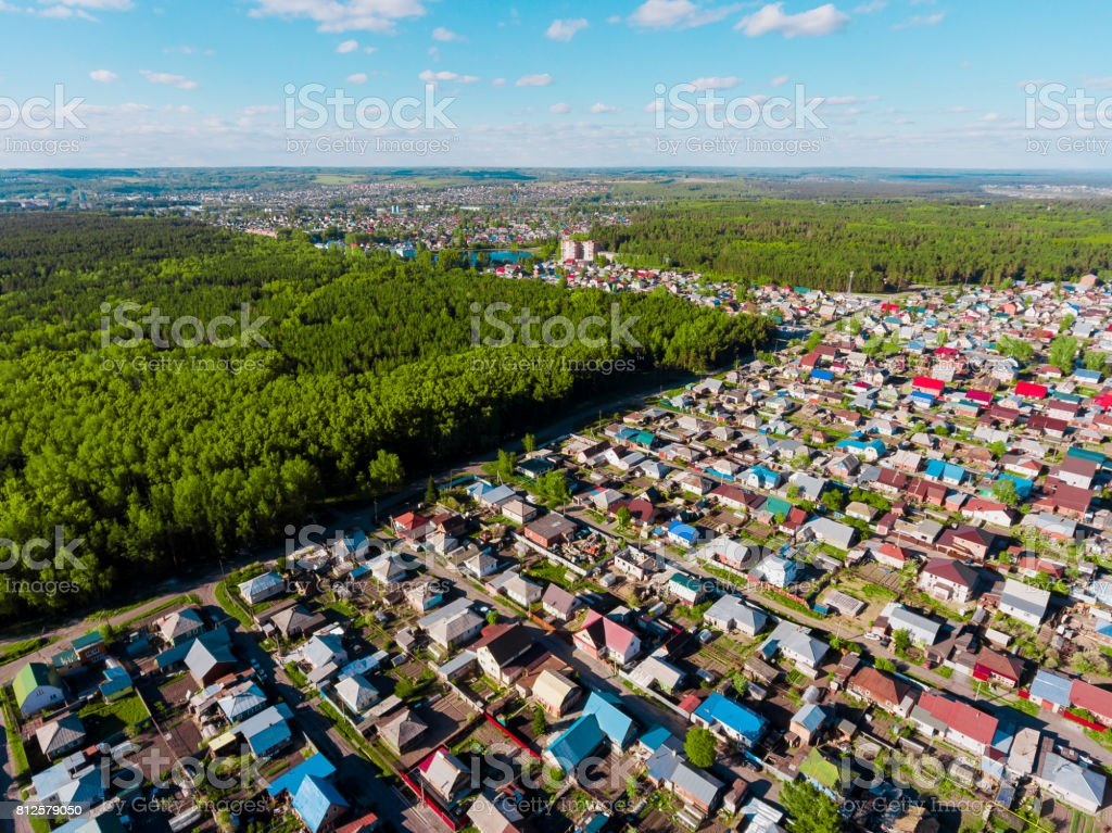Panorama aerial view shot on cottage village in forest, suburb, village. stock photo