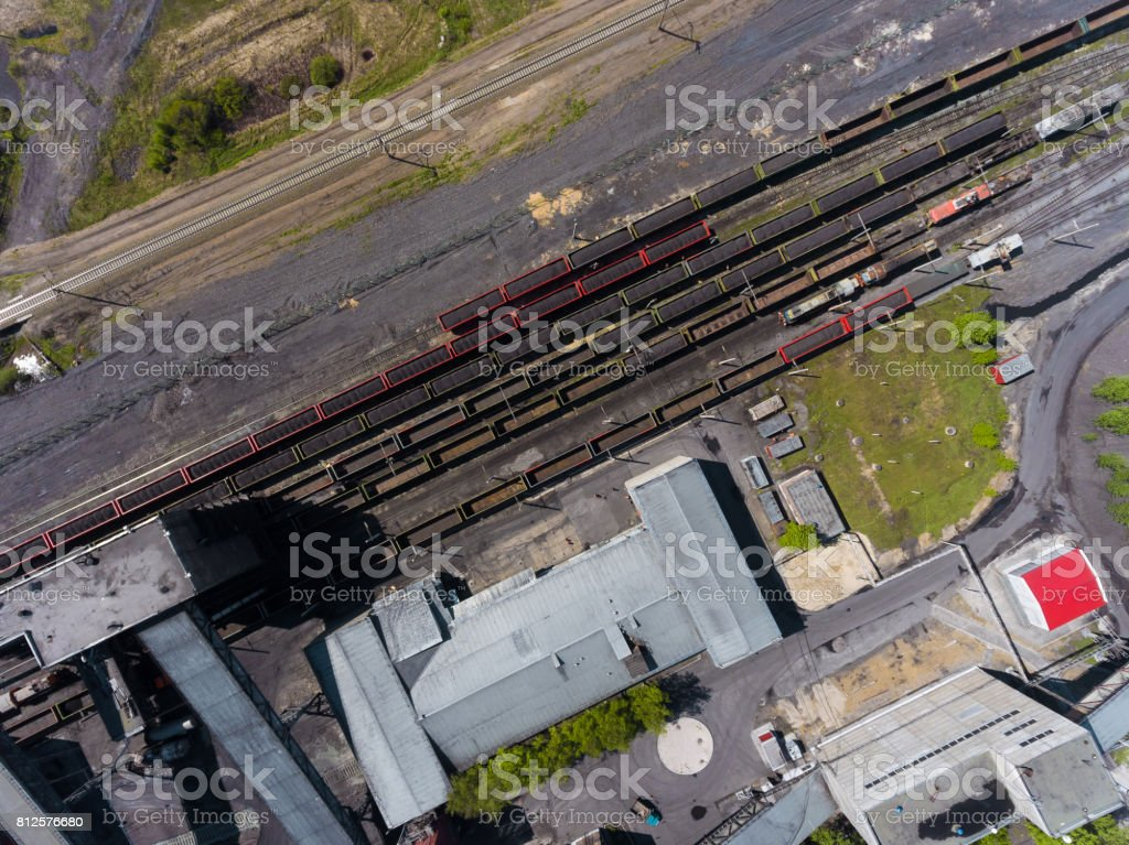 Panorama aerial view shot on railroad tracks with wagons stock photo