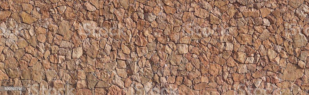 Panorama - Brown Canarian natural stone wall royalty-free stock photo
