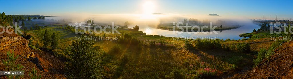 Panorama dawn on the foggy river, russian nature stock photo
