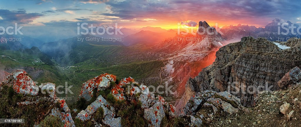 Panorama dramatic sunset in dolomites alp mountain from peak Nuvolau stock photo