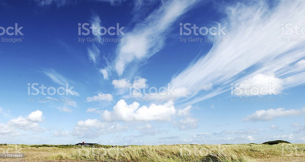 Panorama from denmark with fluffy clouds on blue sky royalty-free stock photo