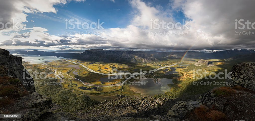 Panorama from top mountain over viewing rapadalen river valley landscape stock photo
