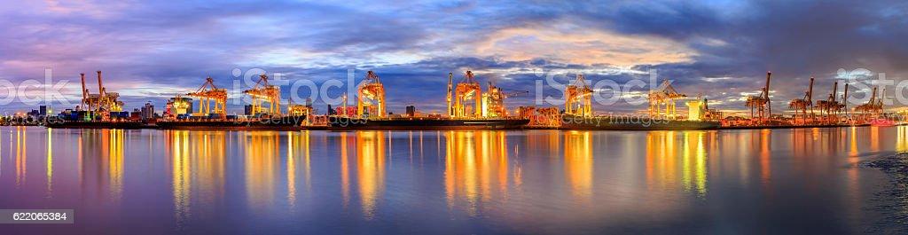 Panorama image working crane loading bridge in shipyard stock photo