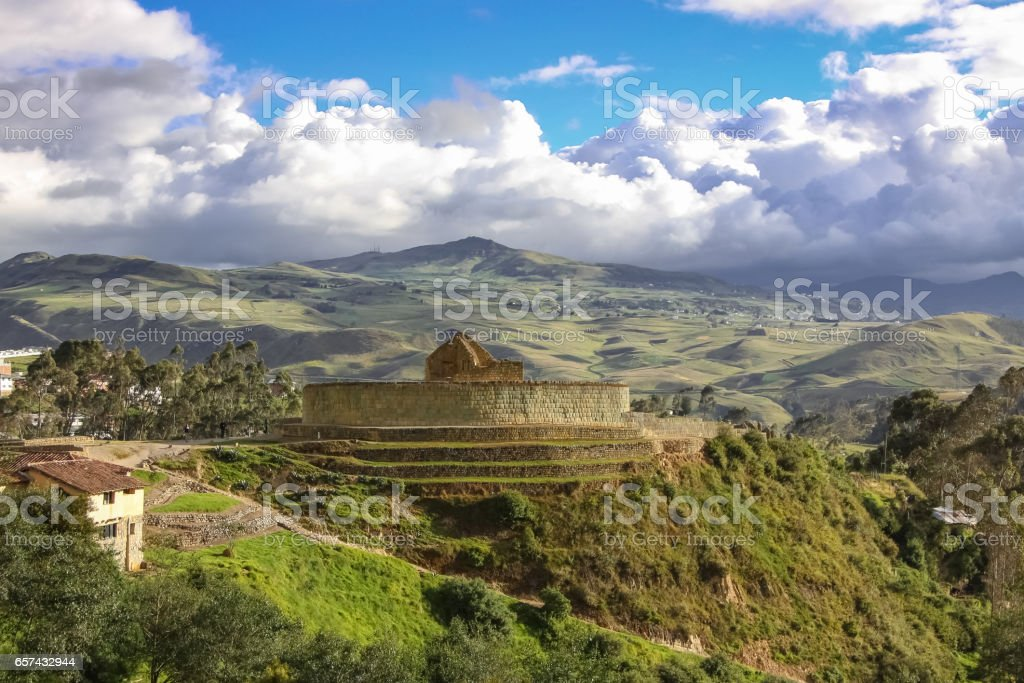 Panorama Inca ruins of Ingapirca and surrounding green andean landscape with dramatic sky stock photo
