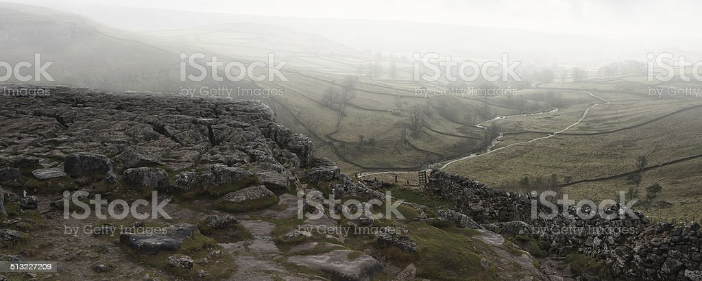 Panorama landscape foggy Autumnal view over limestone crag to va stock photo